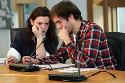 School pupil and university student talking together