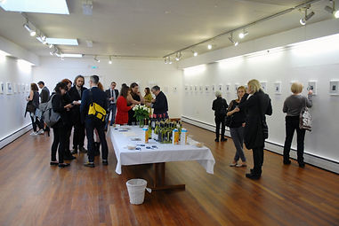 people at gallery exhibition opening