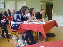 Competition judges sitting at a table