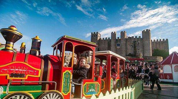 Obidos Castle Portugal Christmas celebrations children on train