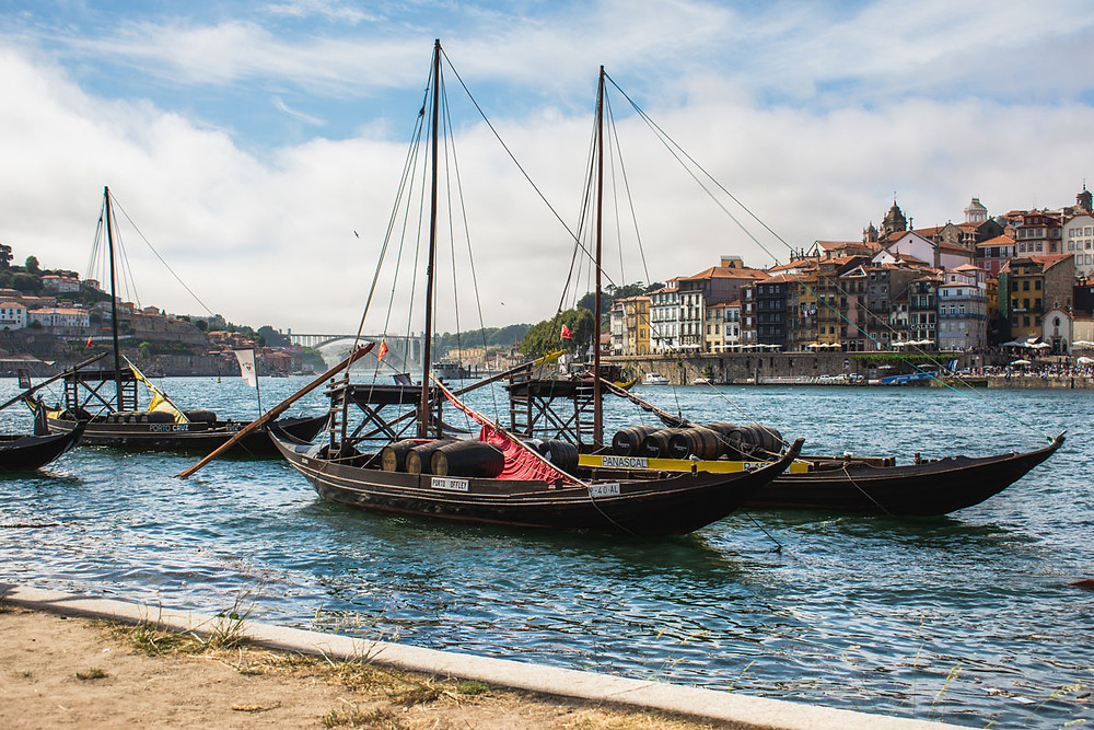Traditional Douro riverboats in Porto Portugal