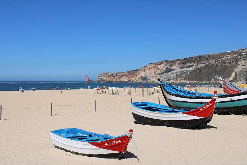 Nazare beach Portugal traditional Portuguese fishing boats
