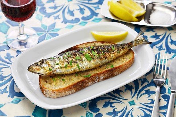 Traditional Portuguese food sardines on bread red wine