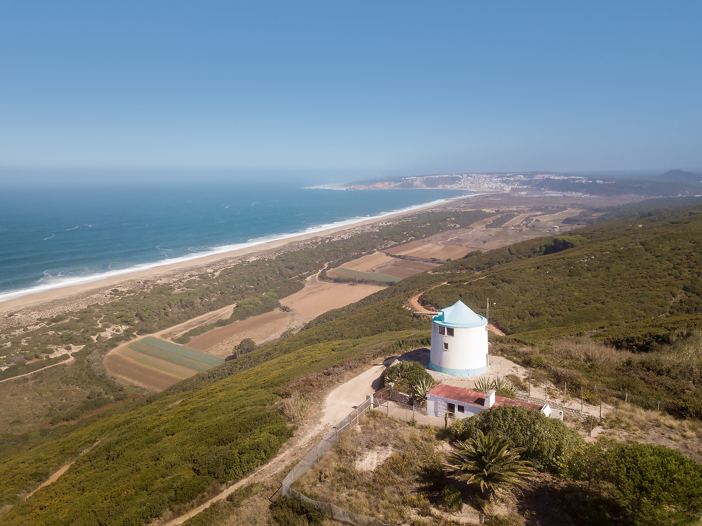 Traditional Portuguese windmills Serra da Pescaria Salgado beach Silver Coast Portugal