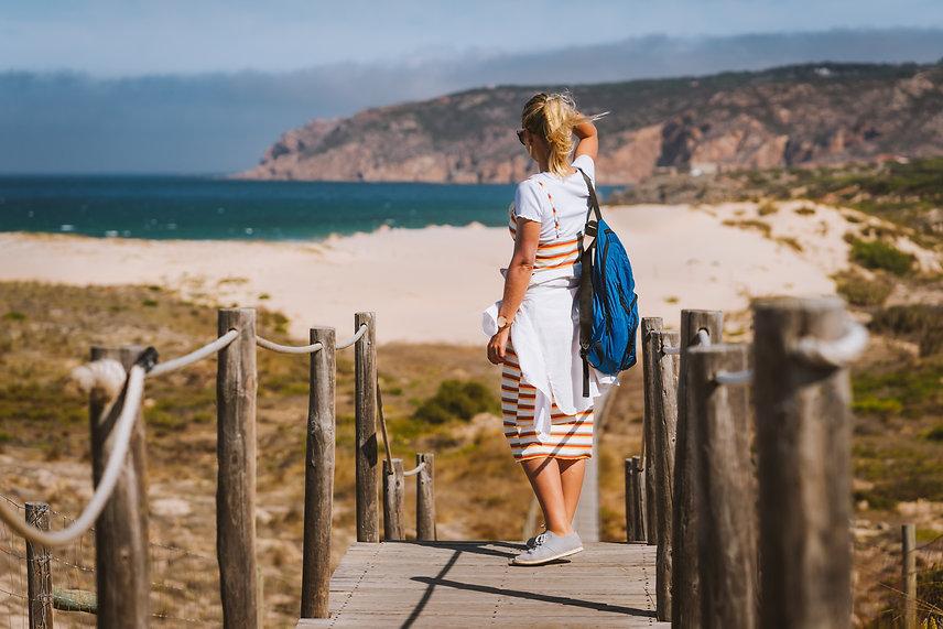 Woman looking beach wooden walkways