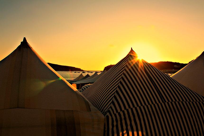 Sunset Sao Martinho do Porto Portugal beach tents bay boats