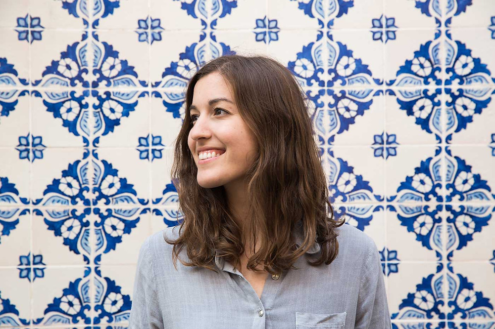 Traditional Portuguese tiles smiling young woman
