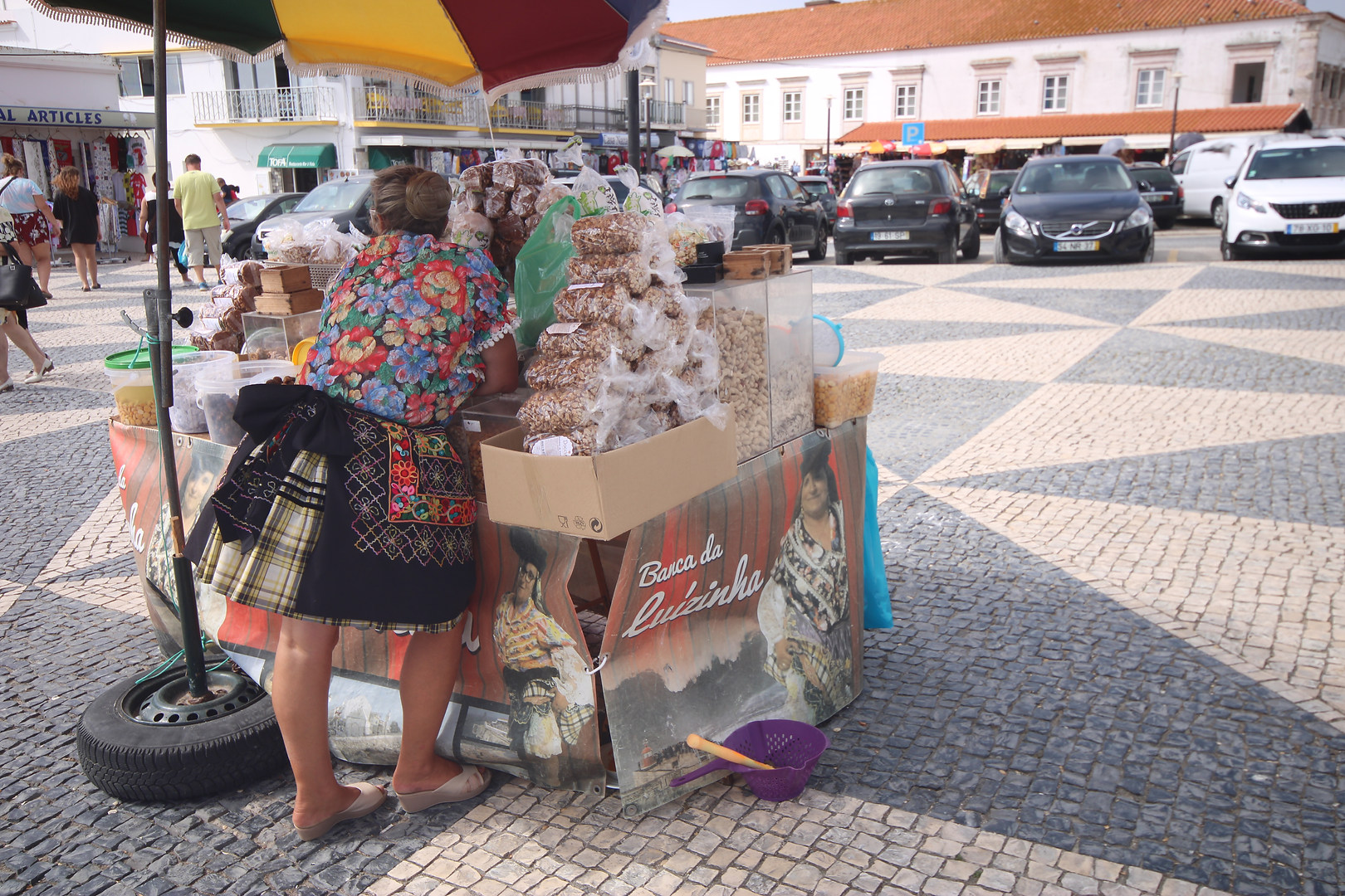 Street vendor traditional seven skirts Nazare Portugal