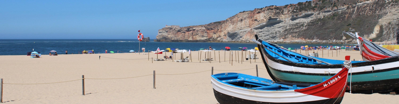 Traditional Portuguese fishing boats Nazare beach Silver Coast Portugal