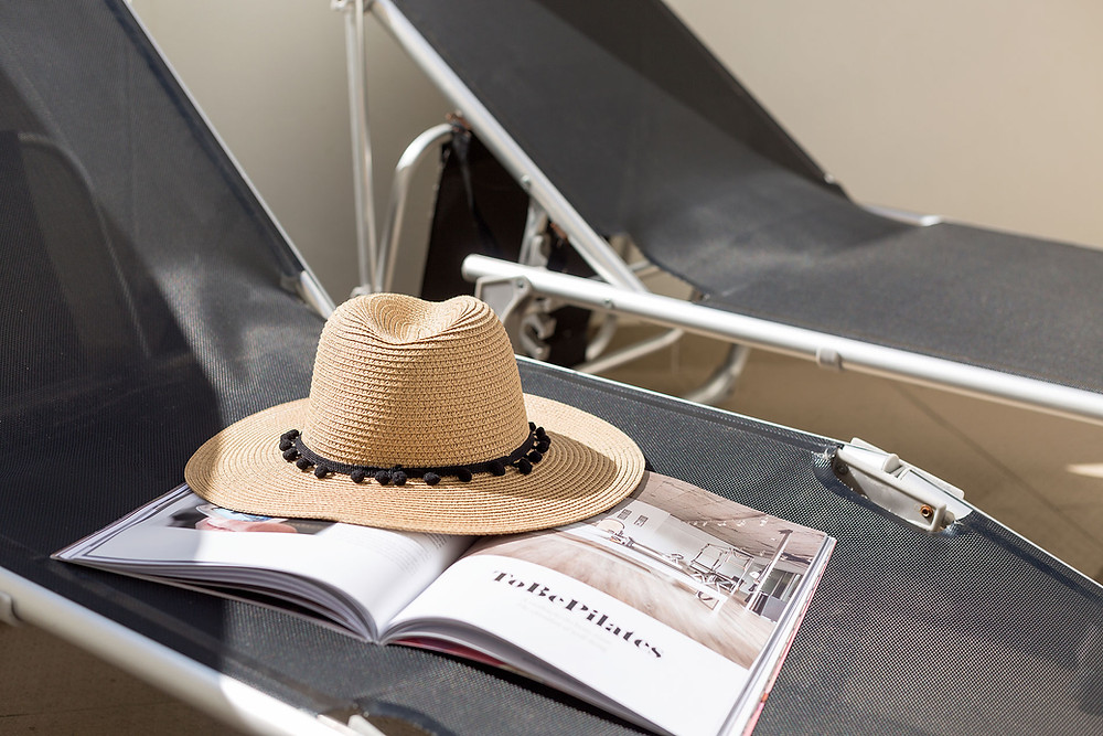 Holidays in Portugal sun lounger and hat by SCH Holiday Homes in Silver Coast Portugal