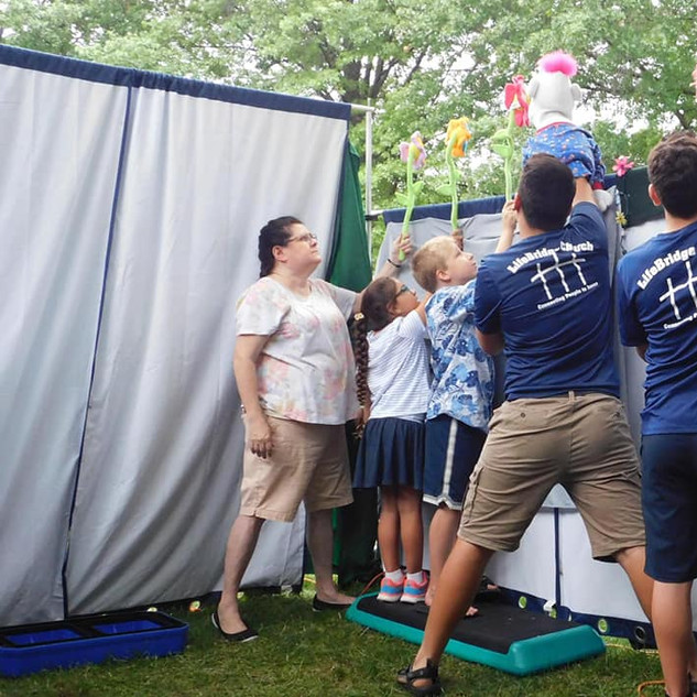 Youth helping with the Spotlight Puppet Team at McManus Park in Bettendorf.