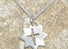 Small star pendant with cross cut out