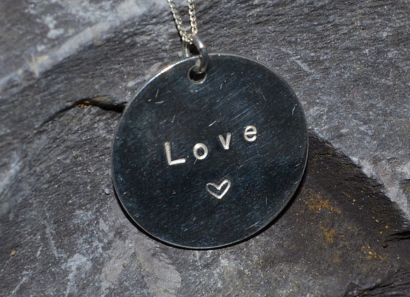'Love' & heart stamped silver pendant