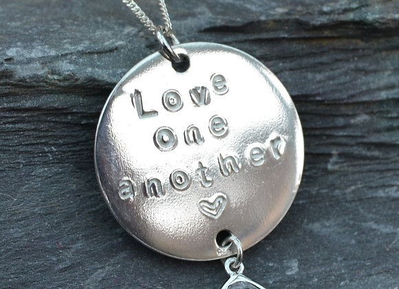 'Love one another' and heart stamped disc pendant with cubic zirconia drop