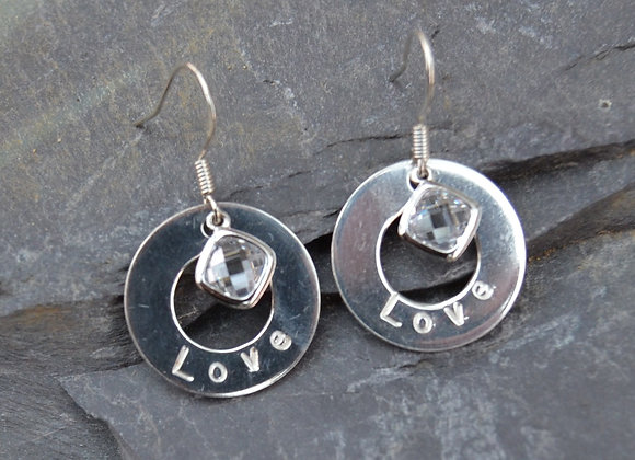 'Love' stamped silver washer earrings with cubic zirconia drops