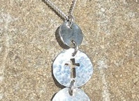 Three disc with cut out cross pendant