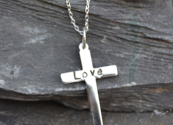 Silver cross with 'Love' stamped