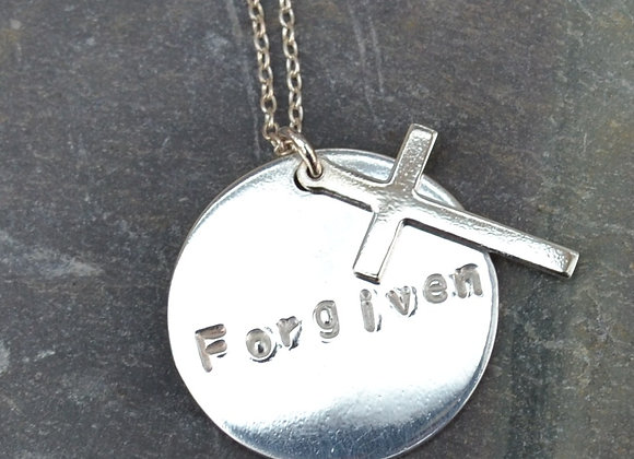 'Forgiven' stamped silver disc and cross pendant