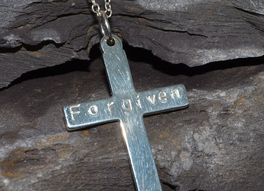 'Forgiven' stamped silver cross