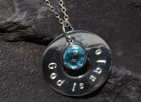 'God is able' stamped silver washer pendant