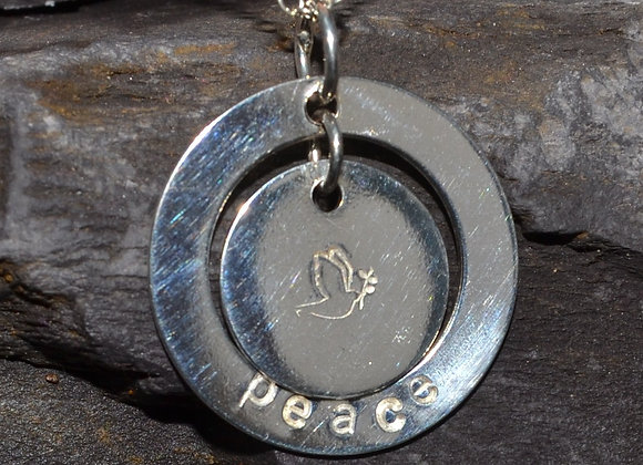 'peace' and dove stamped washer pendant