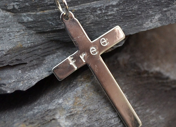 Silver cross with 'free' stamped