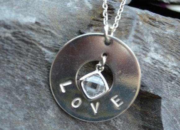 'LOVE' stamped silver washer pendant with cubic zirconia
