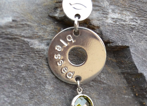 'blessed' and fish stamped silver washer and disc pendant with cubic zirconia
