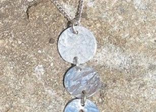 Silver three discs with fish cut out