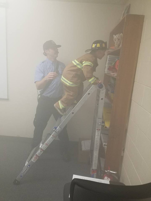 McConnell helped Ryder Nickerson climb up the ladder to save a cat