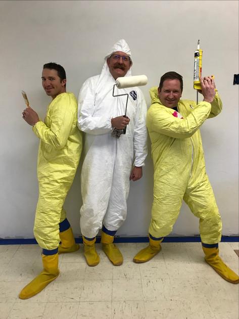 Travis Falter, Lt. Scott Tweedy, and Avery St. John painting the kitchen