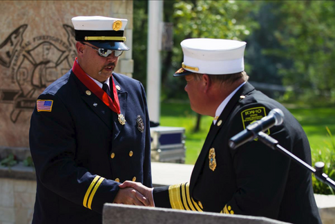 Dave Krumenacker accepting his Medal of Honor