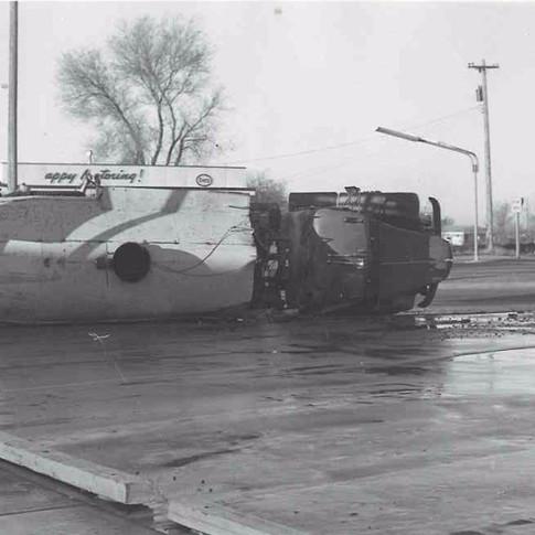 Tanker on its side in front of Keslers Market