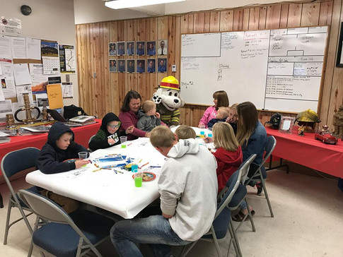 Sparky helping kids draw a map of their house