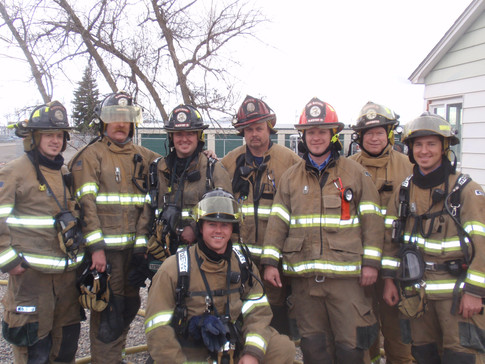Left to right top row: Steve Stuart, Scott Tweedy, Lt. Dave Goodwin, Capt. Dave Krumenacker, Fire Marshal Ben Hirschi, Mike Gardner, Travis Falter. Bottom: Drew McConnell