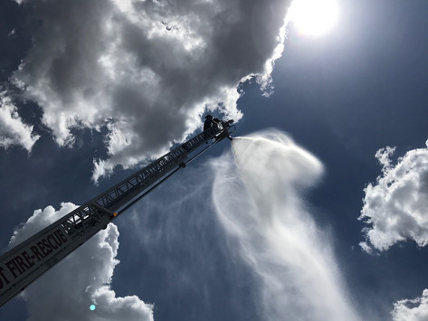 Tyler Wise flowing water through the Aerial nozzle on Ladder 1