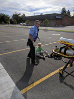 "Paramedic Bryon Howell helping a ""patient"" at a BMH training"