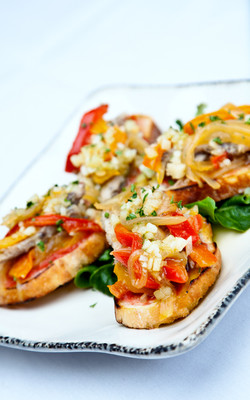 Delicate Sardine fillets, sweet red onion, red peppers, Manchego cheese on toasted baguettes