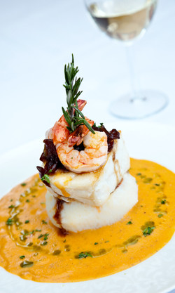 Chilean Sea Bass served with Caramelized Onions in a creamy Shrimp Sauce