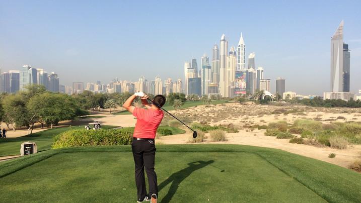 Martin hitting a drive at The Emirates Golf Club, Dubai