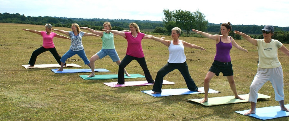 outside yoga in a line