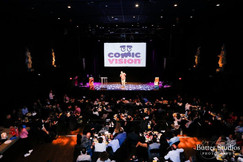 Audience watching comedian on stage