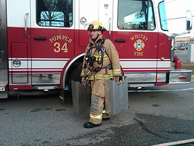 Firefighter with cylinder holder carrier