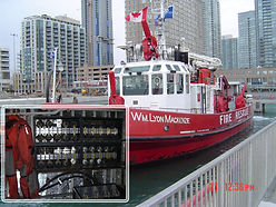 Storage rack for SCBA cylinder holder carrier used on a fire boat