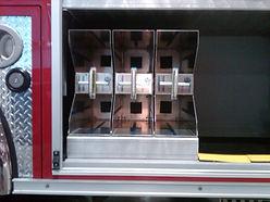 Firetruck with SCBA cylinder holder carrier