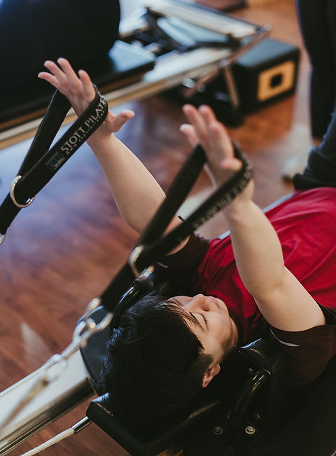 Pilates student in Seattle, WA on Pilates reformer.