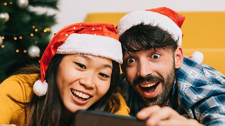 friendly-couple-taking-selfie-christmas_