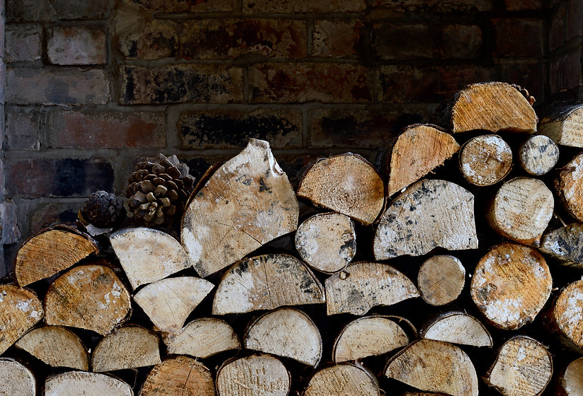Rustic logs stacked in a holiday cottage