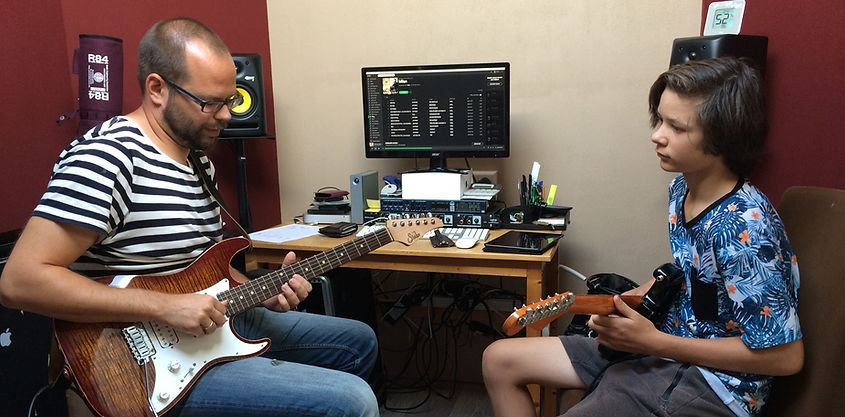Gitaarles in professionle studio