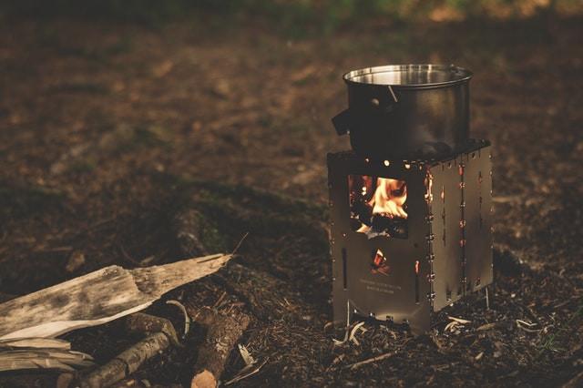 A burning camp stove after dark.
